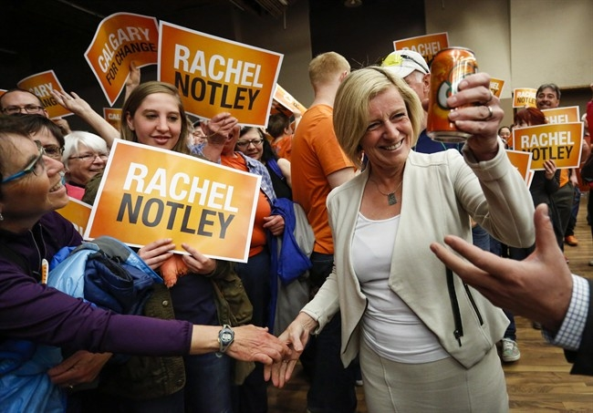 Alberta NDP Leader Rachel Notley holds a can of orange Crush soda pop as she enters a campaign rally in Calgary, Alta., Saturday, May 2, 2015.