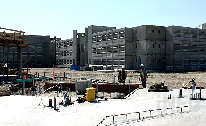 A view of the prisoners' cell pods with the slab for the correctional centre's administrative building in the foreground.