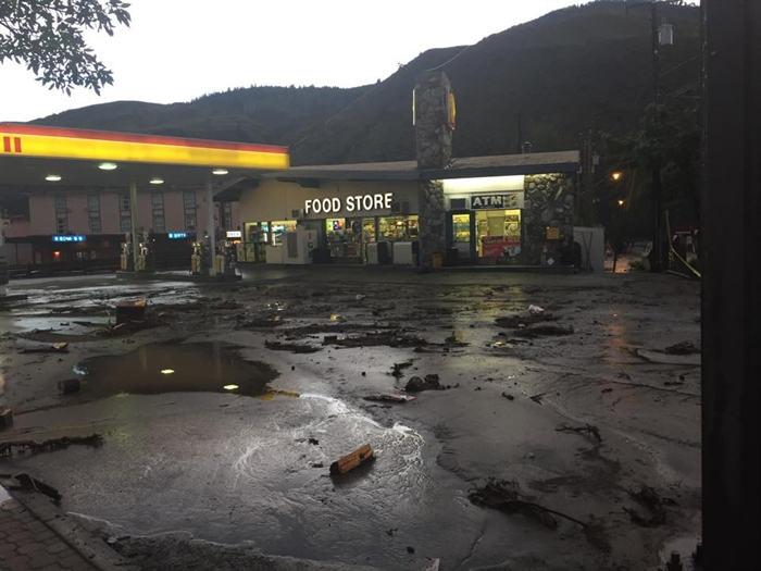 Debris left behind at a gas station in Cache Creek after the water from the flash flood receded, Saturday, May 24, 2015.