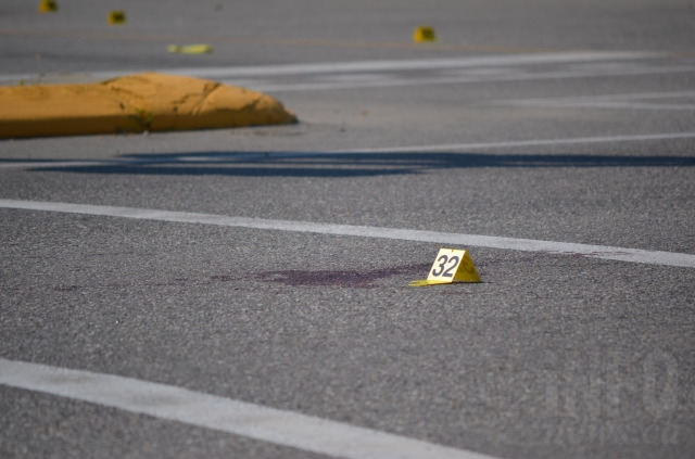 Police have numerous evidence markers laid out around the scene.