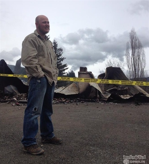 Cory George after the store burned down in 2014.