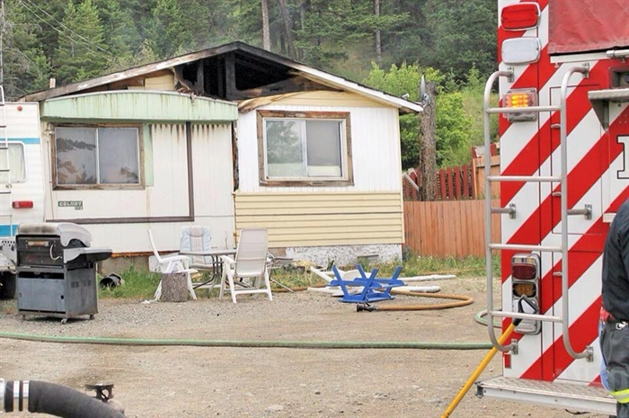Firefighters mopped up the blaze that consumed a home at the Iron Mask Mobile Home Park June 1
