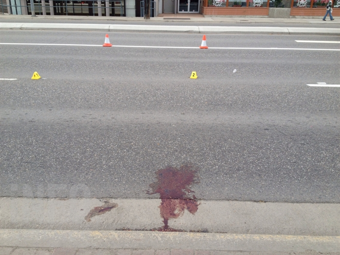 RCMP the woman hit by a Nissan Pathfinder on Highway 33 in front of Coopers Foods, Monday, June 1, 2015. was crossing the road outside the crosswalk.