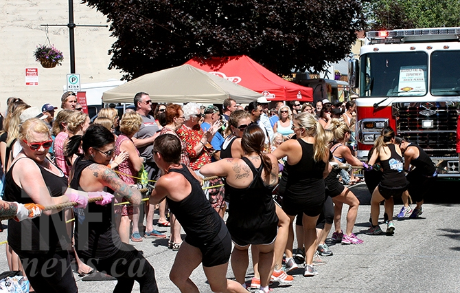 The media team pulls their way to a win against Penticton Auxilary during Saturday's fire truck pull.