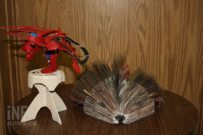 A couple of examples of native art offered by students at En'owkin Centre include these pieces, both fashioned out of paper. The porcupine took more than 900 sheets to create.