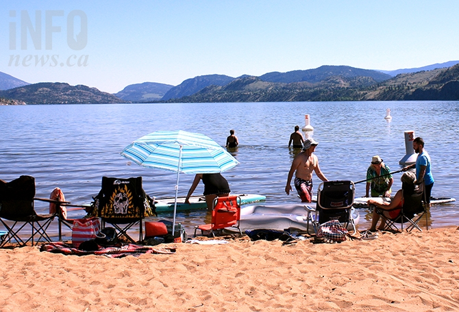 Beachgoers take to stand up paddleboards Monday afternoon at Sudbury Beach.