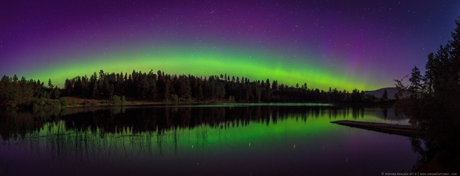 A six image stitch of the northern lights reflecting on Brunell Lake near Oliver BC.