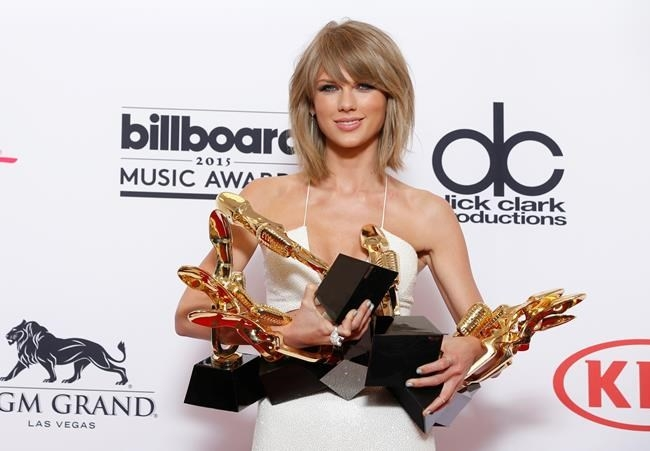 "In a May 17, 2015 file photo, Taylor Swift poses in the press room with the awards for top Billboard 200 album for ""1989"" at the MGM Grand Garden Arena, in Las Vegas. In an open letter to Apple, on Sunday, June 21, 2015, Swift criticized the company's new streaming music service for failing to pay artists for a free three-month trial."