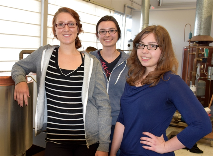 Students Katiana Pyper, Robyn McArthur and Corrie Belanger, left to right, will spend the summer working as part of Dr. Van Hamme's research team.