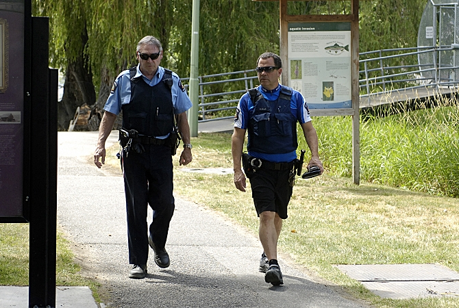 Bylaw officers patrol Lake Ave. beach access on June 24, 2015. Area residents say not enough is being done too keep them safe.