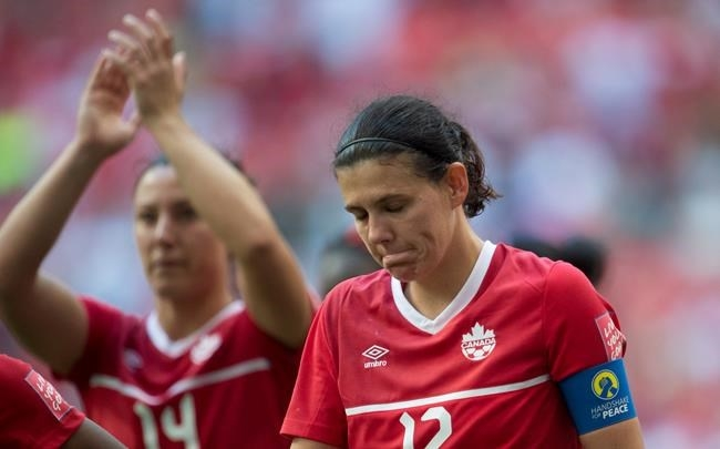 Canada's Christine Sinclair reacts to her teams 2-1 lose to England following the second half of FIFA World Cup quarter-final soccer in Vancouver, B.C. Saturday, June, 27, 2015.