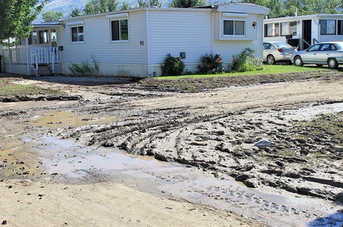 Some roads in the park are now caked in sludge while crews work to clean it up so residents can come back home.