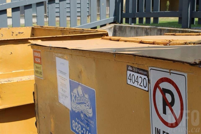 A Kelson Group dumpster is bolted shut on Dalgleish Drive.
