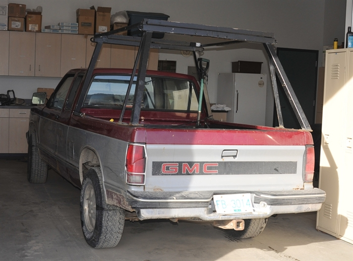 Ronald Teneycke may be driving a 1990, two-tone, red and grey extended cab GMC quarter-ton truck that may have a box rack.