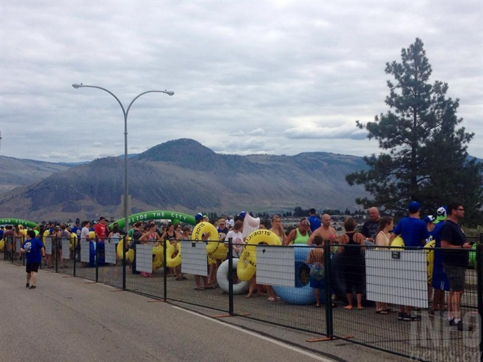 The lineups were long for the Slide the City giant slip and slide on Hillside Drive in Kamloops, Saturday, July 18, 2015.