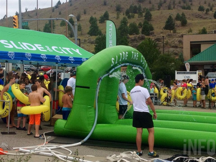 Slide the City set up a 1000-foot slip and slip on Hillside Drive in Kamloops, Saturday, July 18, 2015.