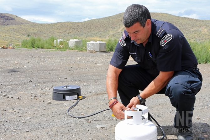 Sheldon Guertin of Kamloops Fire Rescue shows how to use properly use a propane device allowed under a campfire ban.