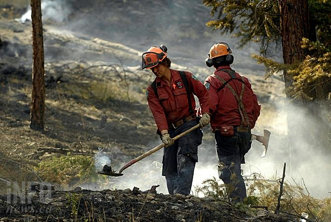 Crews work to contain the Westside Road wildfire Wednesday, July 23, 2015. The fire remains one of two fires of note in the Kamloops Fire Centre a week later.