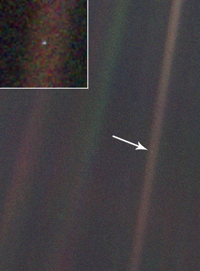 Earth is the barely visible centre right dot, captured in a striation of light from the sun reflecting on the camera lens.