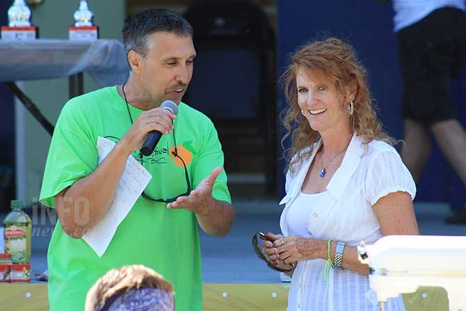 SOcountry radio MC Dennis Walker speaks with Downtown Penticton Association Executive Director Kerry Milton during the Chefs Cook Off in Gyro Park Friday, August 7, 2015.