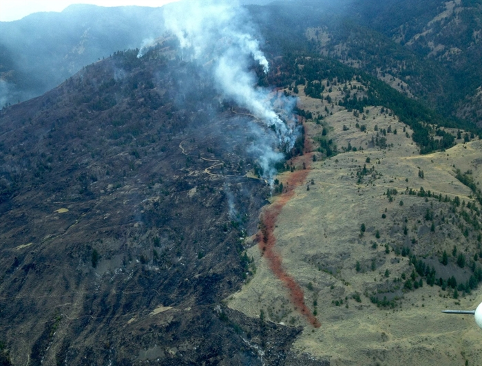The Testalinden Creek fire is seen in this aerial photo on Saturday, Aug. 16, 2015 contributed by the B.C. Wildfire Service.