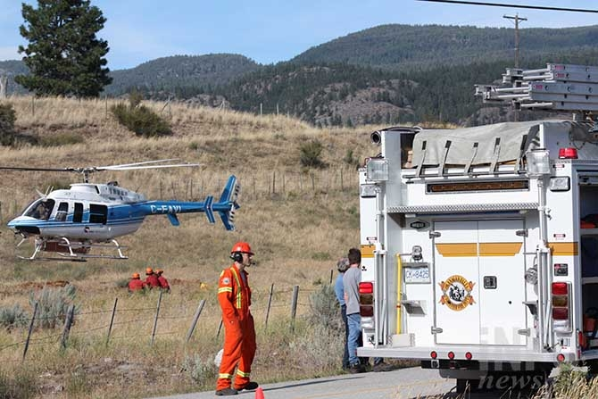 BC Wildfire crews arrive to help Okanagan Falls Volunteer Fire Department stop a wildfire on McLean Creek Road this afternoon.