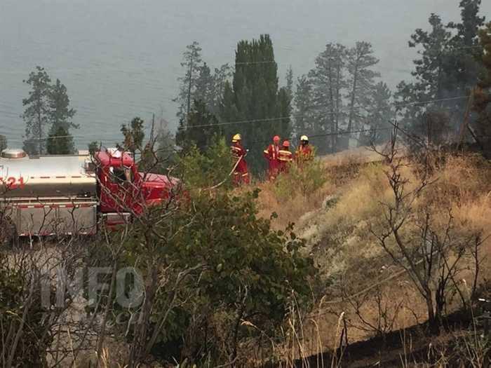 A Peachland Fire Department water tender was used to fight a grass fire in the city, Monday, Aug. 24, 2015.