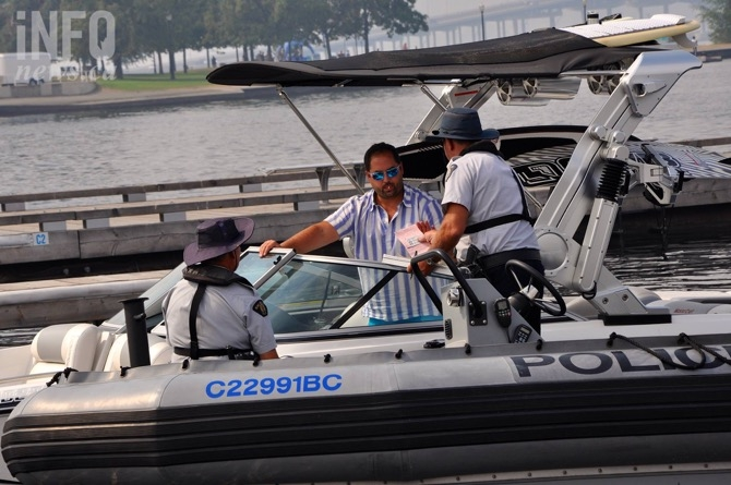 RCMP reserve constables Randy Ferris and Phil Boissonault of the marine enforcement unit give out a warning to a boater.