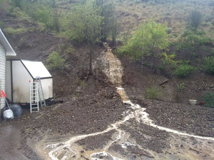 The mudslide behind Tokla and Bob's home after a flash flood earlier this summer.
