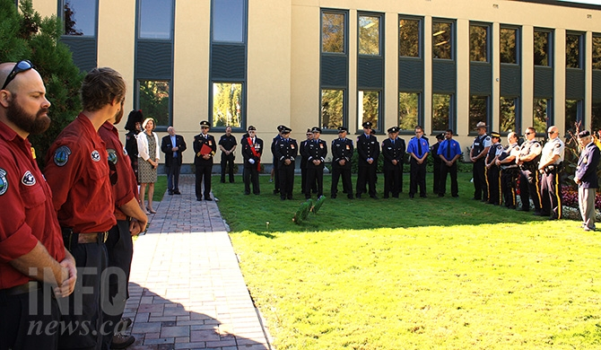 Penticton's emergency service personnel and Armed Forces veterans gather on Friday, Sept.11, 2015 to pay tribute to fallen members and commemorate the anniversary of the 9/11 terrorist attack on the World Trade Centre in Penticton's Veteran's Park.