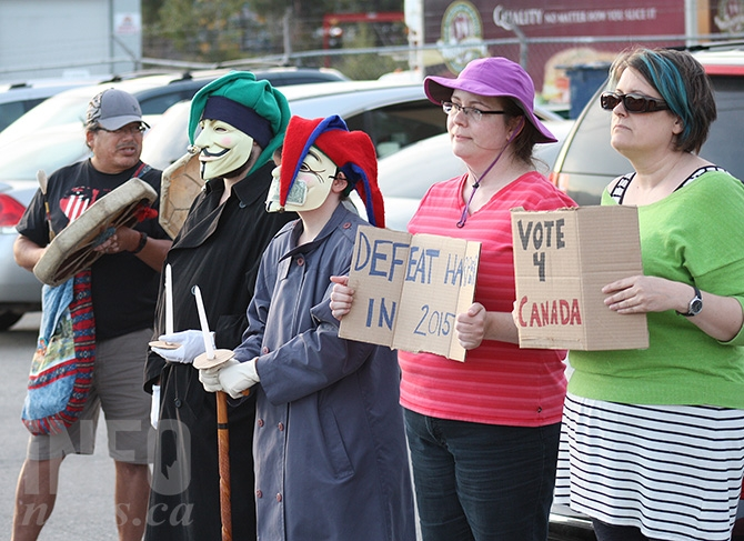 Protesters were lined up at the entrance to Brutus Truck Bodies on Okanagan Avenue East following Harper's visit to Penticton this evening, Sunday, Sept.13.