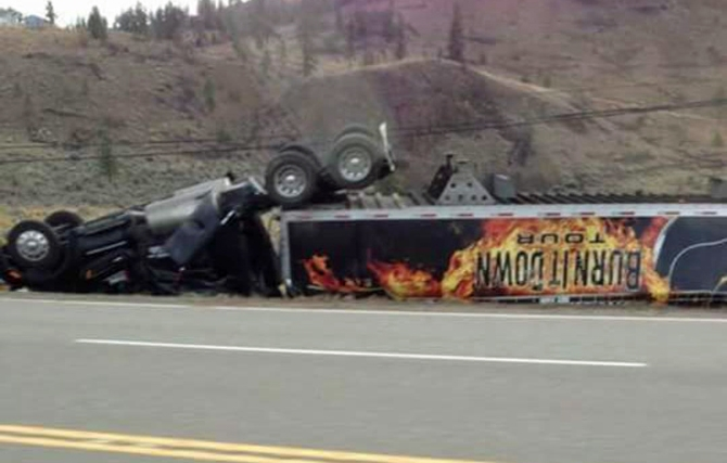 A truck carrying equipment for Jason Aldean's Burn it Down tour flipped near Cherry Creek early this morning, Oct. 6, 2015.