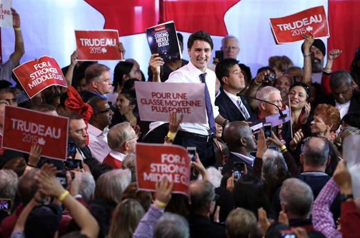 Liberal leader Justin Trudeau can be seen in this contributed photo surrounded by party supporters at a rally in Nepean, Ont., Monday, Oct. 12, 2015.
