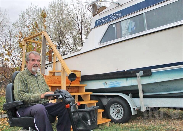 Getting onto the boat was next to impossible after Glenn was wheelchair bound. But instead of giving up fishing, he simply constructed stairs to access the boat and prep it for the summer months.