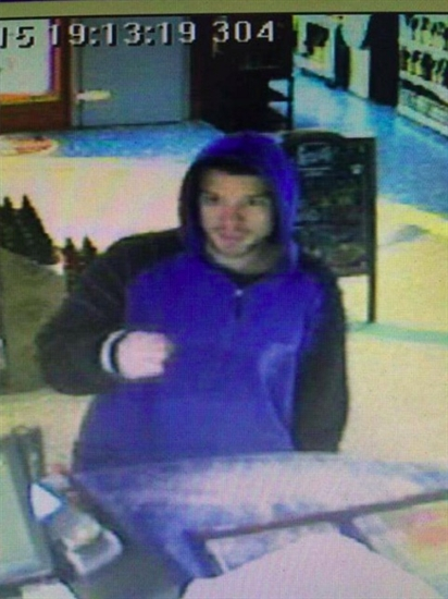 Police are looking for this man in connection with the poppy donation theft at Bosley's, and the theft of a tip cup at Kalamalka Wine and Spirits the same night.