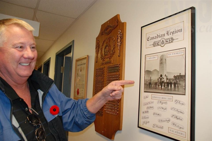 Craig Thomson points to the Legion 52's founding members.