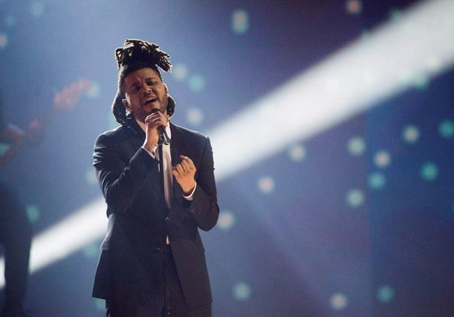 FILE PHOTO - The Weeknd performs during the 2015 Juno Awards, in Hamilton, Ont., on March 15, 2015.