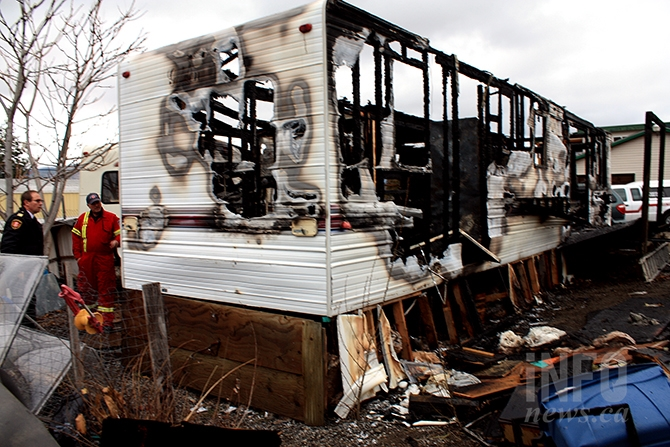 Penticton fire department officials investigate a blaze that destroyed a trailer and outbuilding, and damaged another trailer in the city's industrial park last night.