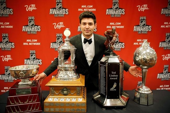 FILE PHOTO - Carey Price of the Montreal Canadiens poses with, from left, the William M. Jennings trophy, the Vezina Trophy, the Ted Lindsay Award trophy and the Art Ross trophy after winning the awards at the NHL Awards show in Las Vegas on June 24, 2015.