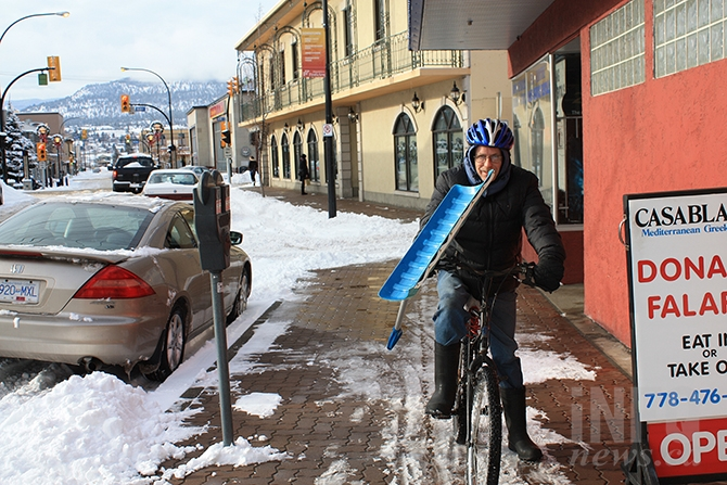 Peter Cummings was able to get around downtown Penticton on a bicycle, in spite of the weekend's heavy snow - carrying a snow shovel to boot.