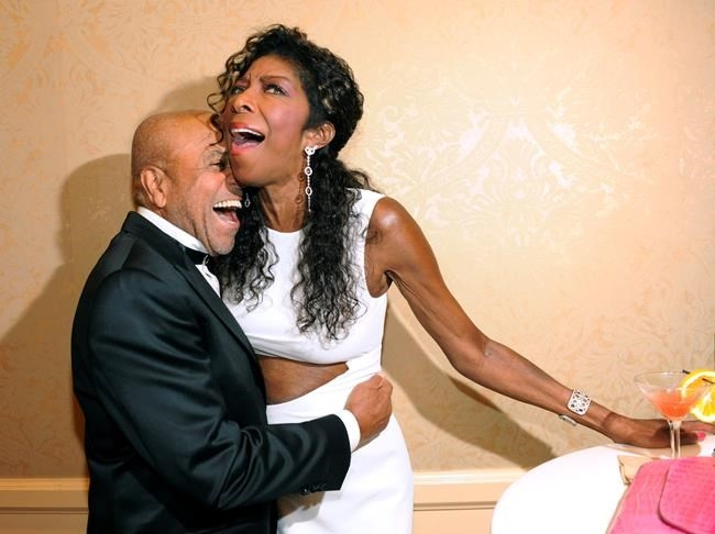 FILE PHOTO- In a Saturday, Oct. 11, 2014 file photo, Motown Records founder Berry Gordy, left, embraces singer Natalie Cole at the 2014 Carousel of Hope Ball at the Beverly Hilton Hotel, in Beverly Hills, Calif. Cole died Thursday night, Dec. 31, 2015.