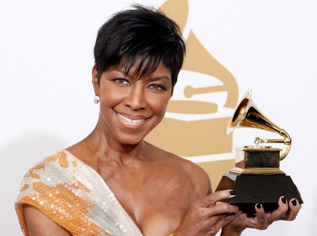 FILE PHOTO - In a Sunday, Feb. 8, 2009 file photo, Natalie Cole holds the best instrumental arrangement accompanying vocalist award backstage at the 51st Annual Grammy Awards, in Los Angeles. Cole, the daughter of jazz legend Nat