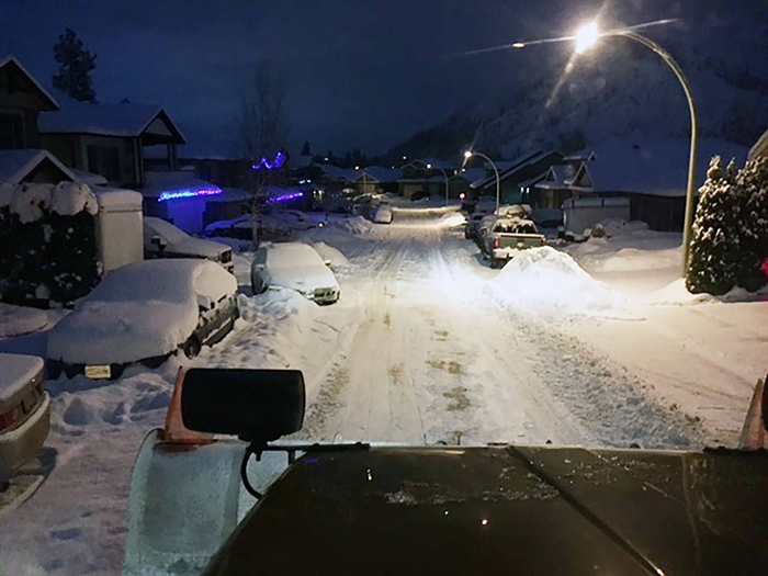 View from a snowplow cab on a West Kelowna street.