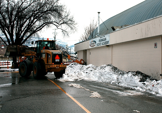 A Penticton public works crew cleans up excess snow from the roof of Memorial Arena, Friday, Jan 8, 2015.