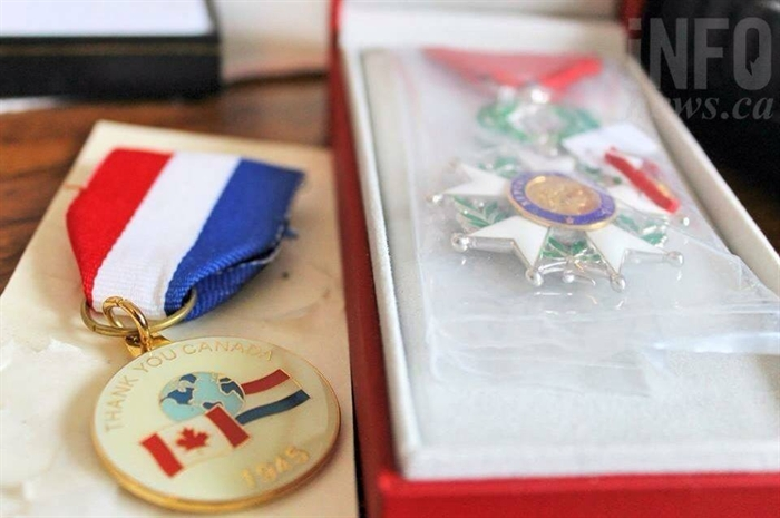 The recently received medal from France is still packaged from its delivery last month. Ford keeps it close to a similar medal from Holland as a thank you for the liberation.