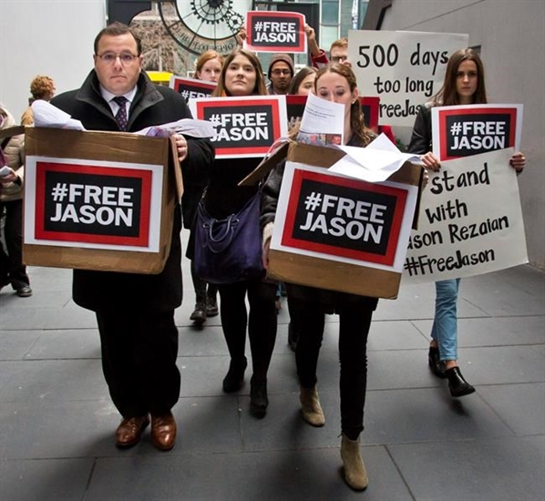 FILE PHOTO - In this Dec. 3, 2015 file photo, Ali Rezaian, far left, the brother of Washington Post reporter Jason Rezaian, rallies with supporters to deliver a petition of 500,000 signatures to Iran's United Nations mission asking for the release of his brother from prison, in New York.