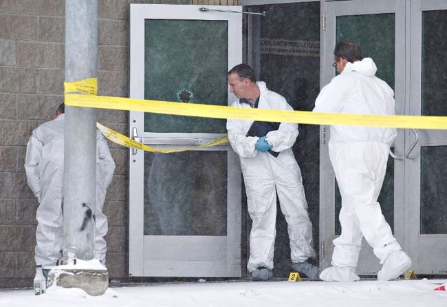 Police investigate the scene on Saturday, January 23, 2016 of a Friday shooting at a school in La Loche Sask. The shooting left four people dead.