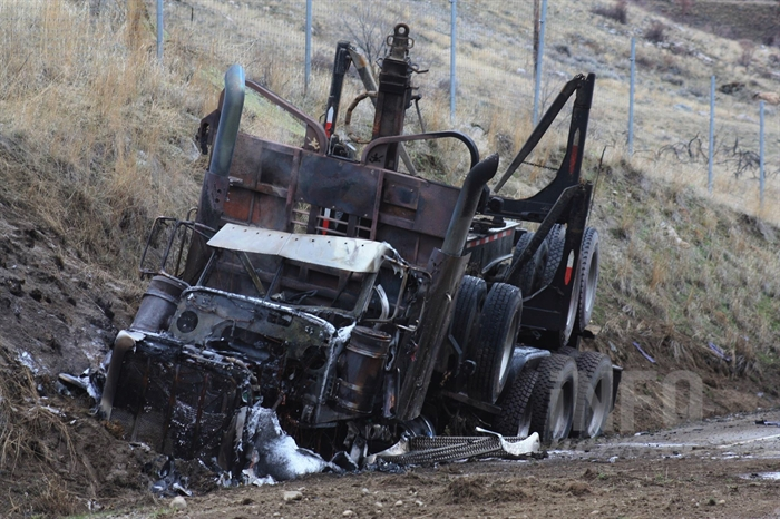An empty logging truck and a sedan collided head-on south of Okanagan Falls on Highway 97, Sunday, Jan. 24, 2016.