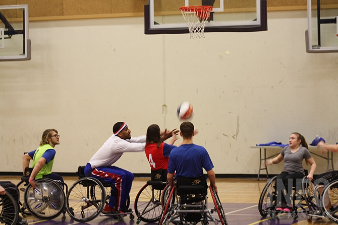 Harlem Globetrotters' Zeus McClurkin tries wheelchair basketball in Penticton on Feb. 25, 2016.