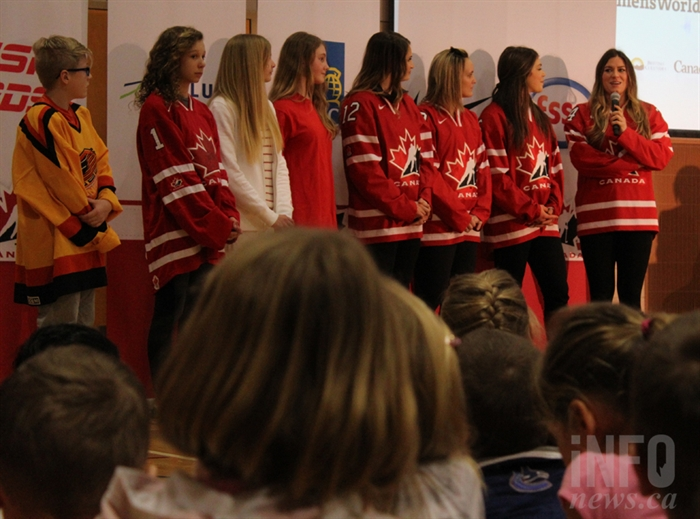Students at Pacific Way Elementary School and Team Canada members listen to Natalie Spooner, 26.